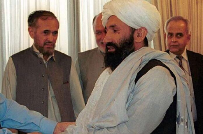 What is Mullah Hasan Akhund's background? What does the Taliban's selection of an interim Prime Minister entail for Afghanistan?